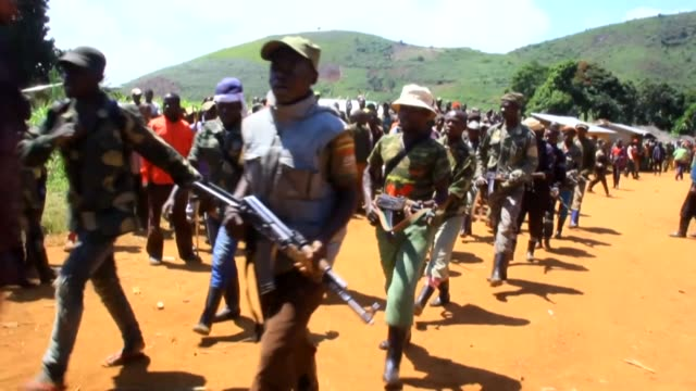 the militia group coopérative pour le développement du congo , accused of being responsible for the deaths of 19 civilians in attacks on three... - war stock videos & royalty-free footage