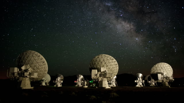 the milky way galaxy moves over radio telescopes at the carma array radio observatory in the white mountains of california. - radio telescope stock videos & royalty-free footage