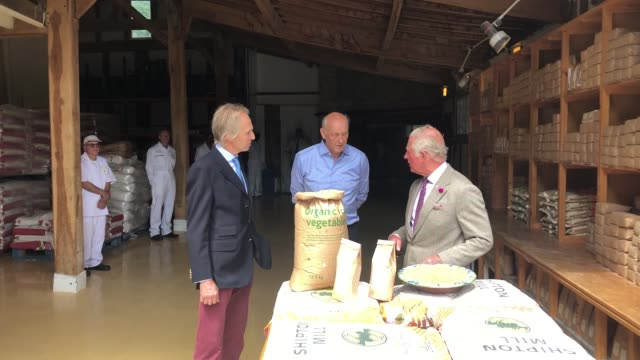 the mill which has seen orders go through the roof as people turned to baking welcomed the prince of wales charles toured shipton mill near tetbury... - flour mill stock videos & royalty-free footage