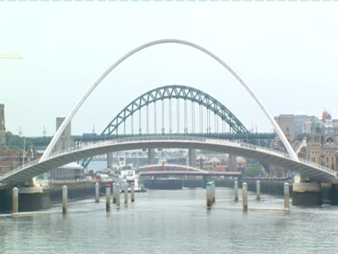the millennium bridge arches over a river. - tyne and wear stock videos & royalty-free footage