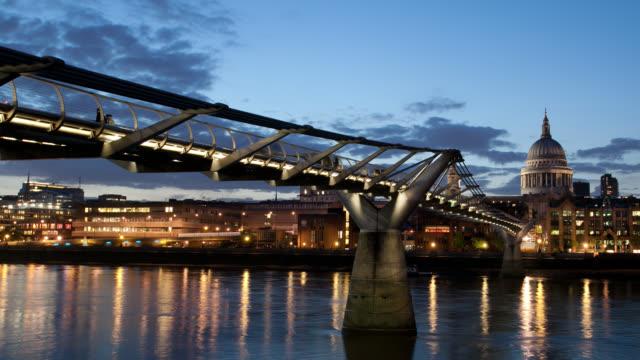 The Millennium Bridge spans the River Thames in London.