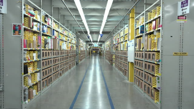 the millionsquarefoot chattanooga fulfillment center which employs thousands opened in 2012 it handles small items such as books dvds and kitchen... - dolly shot stock videos & royalty-free footage