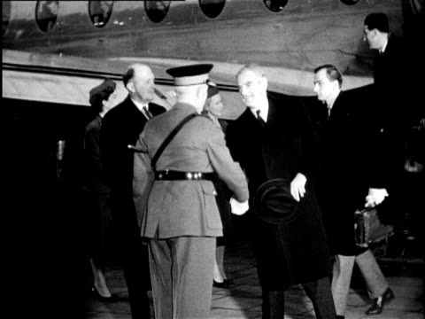 The ministers of Foreign Affairs of France America England and the Soviet Union meet to discuss the future of Berlin which is divided into four areas...