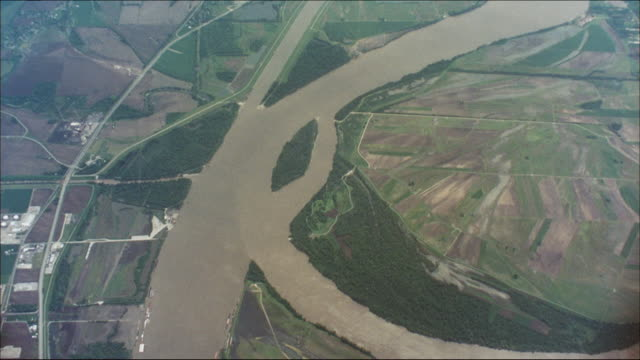 the mississippi river flows past farmland. - missouri stock videos & royalty-free footage