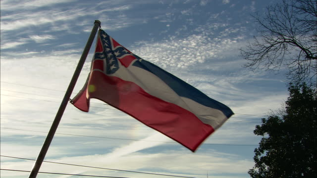 the mississippi state flag waves in a breeze. - confederate flag stock videos & royalty-free footage