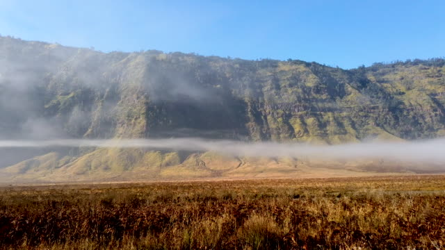 the mist is seen due to a decrease of temperature covered the area of mount bromo on july 16 2019 in probolinggo east java indonesia tenggerese... - tengger stock videos & royalty-free footage