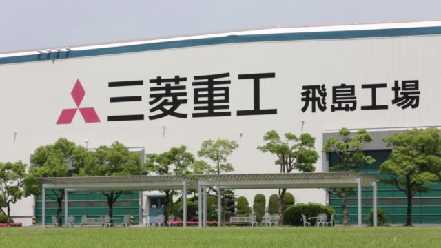 stockvideo's en b-roll-footage met the mitsubishi mu-2 aircraft, left, stands on display in front of mitsubishi heavy industries ltd.'s nagoya aerospace systems works tobishima plant... - plant stage