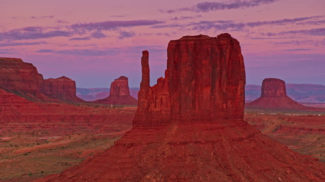 aerial the mittens in monument valley at sunrise - mitten stock videos and b-roll footage