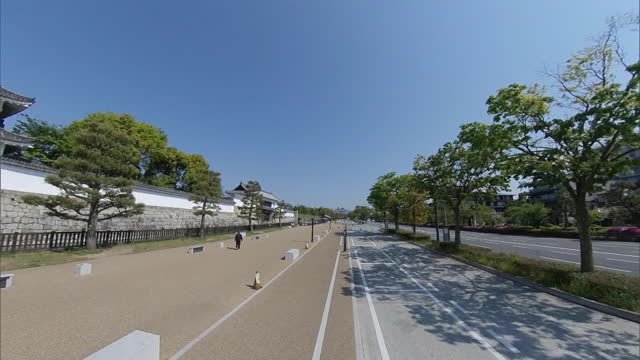 the moat of nijo castle in the city of kyoto. with the moat on the left, the camera heads up horikawa-dori road. nijo castle was built by tokugawa... - moat stock videos & royalty-free footage