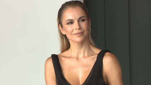 the model águeda lópez, luis fonsi's wife, posing for the press on the 'moda cálida' catwalk - アゲダ・ロペス点の映像素材/bロール