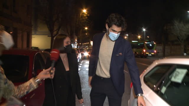 the model juan betancourt and the actress andrea duro leave a restaurant after enjoying a dinner as a couple - フアン・ベタンコート点の映像素材/bロール