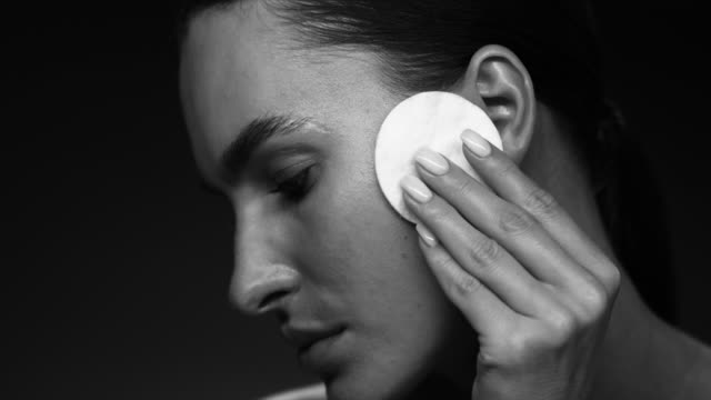 the model uses a cotton pad. supermodel face closeup. make-up - skin care stock videos & royalty-free footage