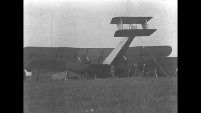 the modified vickers vimy biplane flown by john alcock and arthur brown at crash site with its tail in the air the aviators crossed the atlantic... - 1910 1919 stock videos & royalty-free footage
