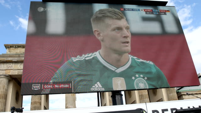 The moment when the German national football team is losing against South Korea Look at the huge screen at the Brandenburg Gate 2018 watching the...