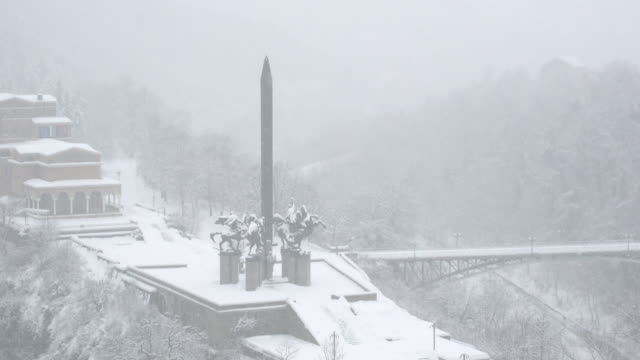 the monument of asenevci in the historic town of veliko tarnovo covered by snow - eastern european culture stock videos and b-roll footage