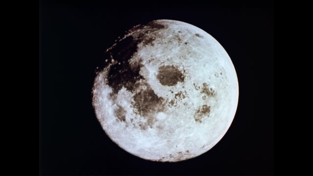 vídeos de stock e filmes b-roll de / the moon as seen from space / neil armstrong inside the lunar module, audio of him chatting with houston mission control. apollo 11 prepares to... - 1969