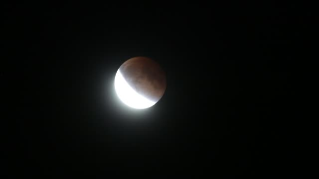 The moon is blood red during the Supermoon Eclipse as it's captured from Bloomington Indiana Sunday September 27 2015 The last time a Supermoon...