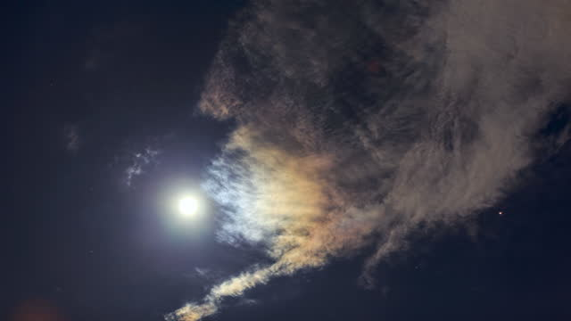 the moon makes the clouds colorful, like a rainbow - moon stock videos & royalty-free footage