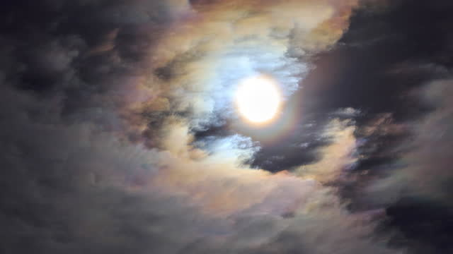 the moon makes the clouds colorful, like a rainbow - light natural phenomenon stock videos & royalty-free footage