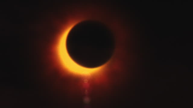 The moon moves across the sun creating a solar eclipse.
