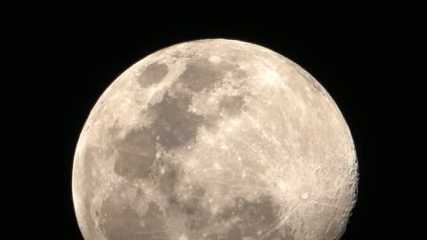 the moon on black background. - moving up stock videos & royalty-free footage
