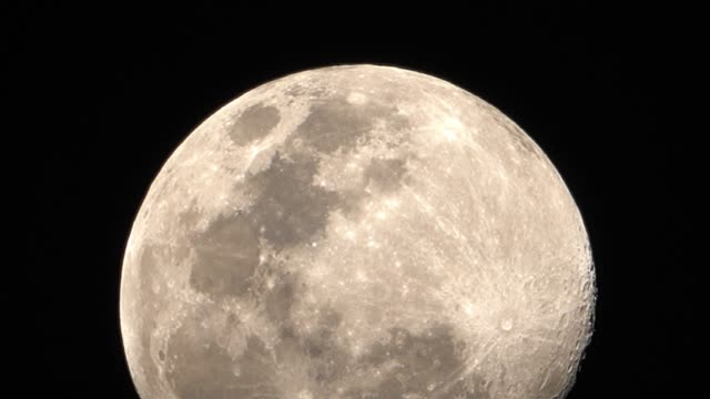 the moon on black background. - full moon stock videos & royalty-free footage