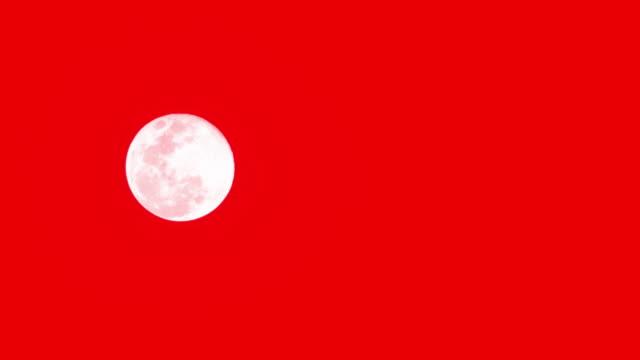vídeos y material grabado en eventos de stock de la luna sobre fondo rojo. - astrología