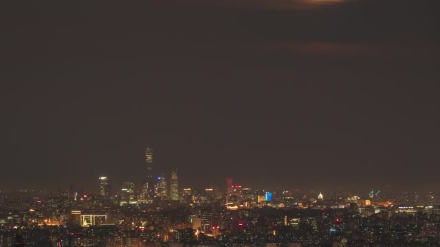 the moon rises over the urban skyline, a transition from night to day on september 2 in beijing, china. - beijing stock videos & royalty-free footage