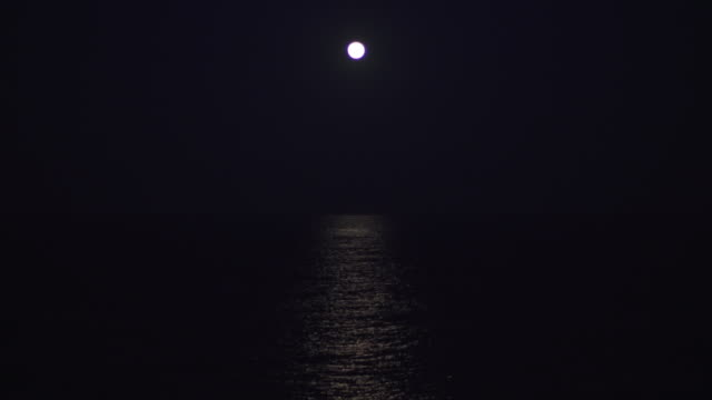 the moon rising over the ocean - moon stock videos & royalty-free footage