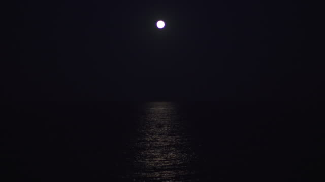 the moon rising over the ocean - seascape stock videos & royalty-free footage