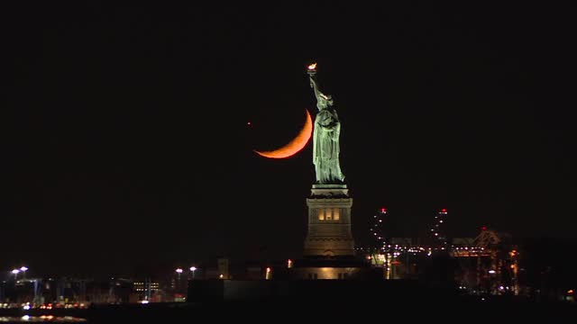 the moon sets behind the statue of liberty on november 18, 2020 in new york city. - statue of liberty new york city stock videos & royalty-free footage