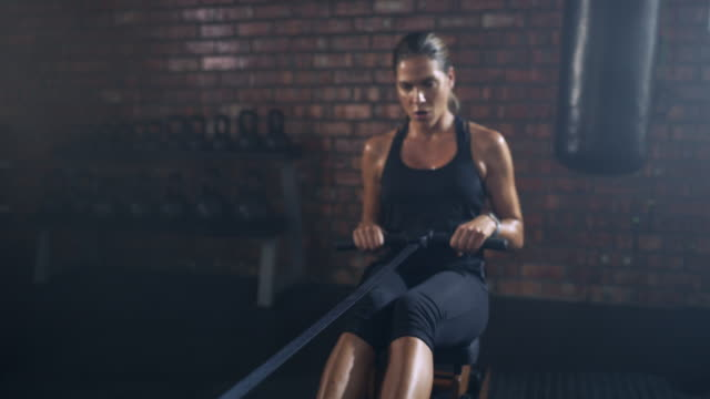 the more you exercise the more rewards you get - rowing machine stock videos & royalty-free footage