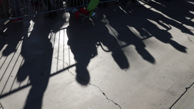"""the morning light creates shadows as supporters of united states president donald j. trump gather at the las vegas convention center for a """"keep... - president stock videos & royalty-free footage"""