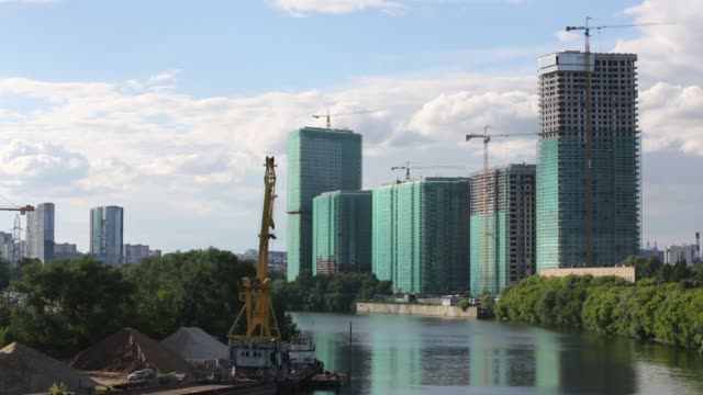 the moskva river leads to the heart of the capital residential apartment complex in the khoroshevo mnevniki district of moscow russia on saturday... - sostituzione video stock e b–roll