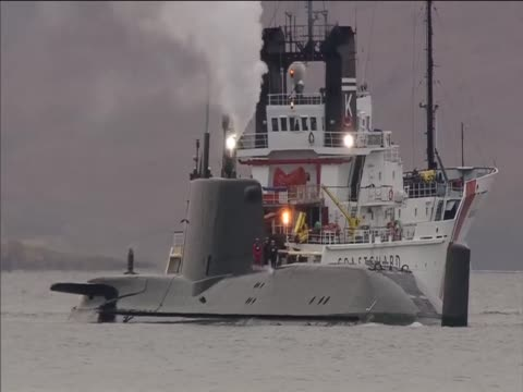 the most advanced british nuclear submarine hms astute stuck on a shingle bank during sea trials - isole ebridi video stock e b–roll