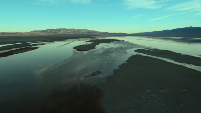 the mostly dry lakebed of owens lake, located in the arid owens valley, california. - basin and range province stock videos and b-roll footage
