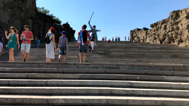 the 'motherland calls' monument overlooking volgograd near the volgograd arena during the world cup 2018 - volgograd stock videos & royalty-free footage
