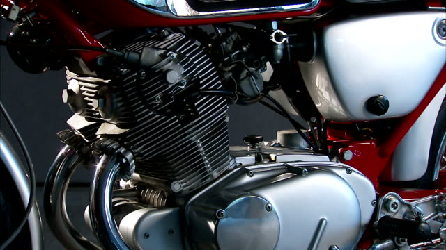 the motor of a motorbike features tubes, gears, and plugs. - motor stock videos & royalty-free footage