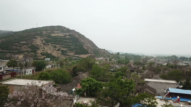 the mountain and farming village  in china - cliff dwelling stock videos & royalty-free footage