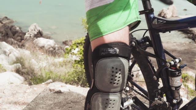 the mountain bike rider in full protective sportswear riding bike - protective sportswear stock videos & royalty-free footage