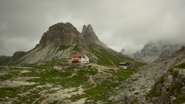 the mountain hut of the three peaks - tre cimo di lavaredo stock videos & royalty-free footage