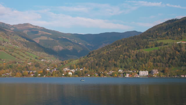the mountain lake and town zell am see in salzburg land in austria - jetty stock videos & royalty-free footage