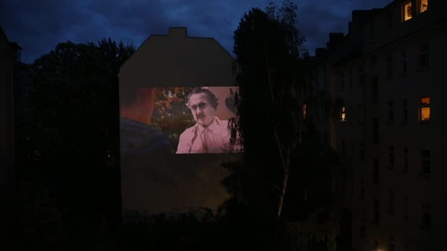 the movie is projected from the home on the backyard firewall of residential building on april 30 2020 in berlin germany the project windowflicks is... - domestic garden stock videos & royalty-free footage
