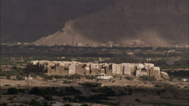 the mud-brick city of shibam lies in a low desert valley in yemen. - yemen stock videos and b-roll footage