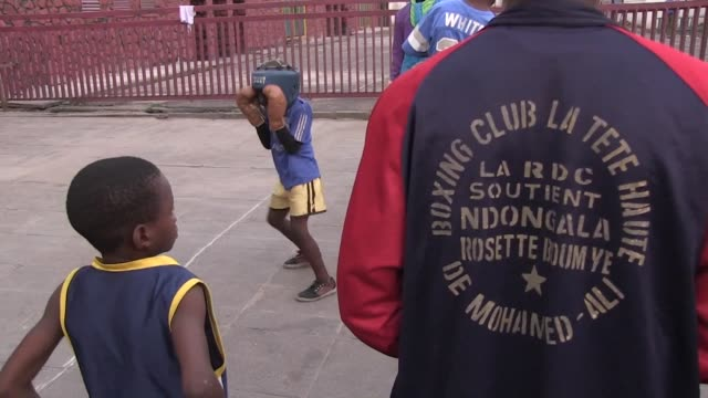 the muhammad ali boxing club in kinshasa dismisses students early upon learning of the heavyweight boxing champions death - heavyweight stock videos and b-roll footage
