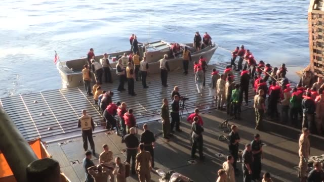The multipurpose amphibious assault ship USS Bataan transferred 277 persons in distress to the Armed Forces of Malta offshore patrol vessel P61...