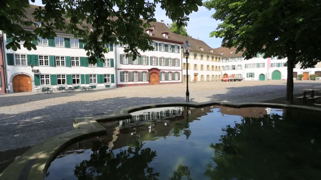 the munsterplatz, city of basel, canton basel stadt, switzerland, europe - kopfsteinpflaster stock-videos und b-roll-filmmaterial