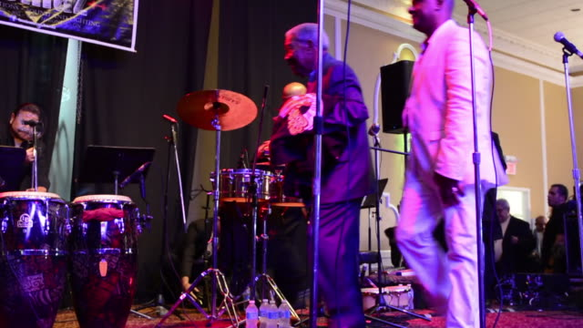 the music band enters the performing stage jerry rivas and charlie aponte with el gran combo singing live in toronto the popular salsa group el gran... - プエルトリコ人点の映像素材/bロール