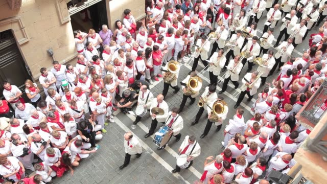 the music band parade through the crowd during the traditional san fermin procession fiesta de san fermin 2012 on july 07 2012 in pamplona spain - comunidad foral de navarra stock videos and b-roll footage