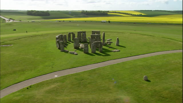 the mysterious rocks of stonehenge tower in salisbury plain, wiltshire, england - obelisk stock videos & royalty-free footage